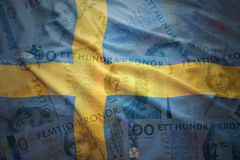 Waving swedish flag on a swedish crown money background Royalty Free Stock Photography