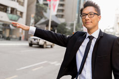 Waving for a taxi in city Stock Photography