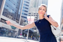 Waving for a taxi in city Royalty Free Stock Photos