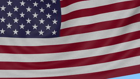 Waving textile textured flag of the USA, seamless loop against blue background. 4K ProRes with alpha stock footage