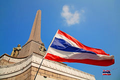 Waving Thai flag against Victory monument Royalty Free Stock Photography