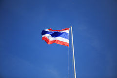 Waving Thai flag with blue sky. Background Royalty Free Stock Images