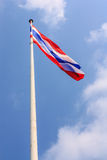 Waving Thai flag. With blue sky background Royalty Free Stock Photography