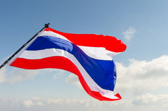 Waving Thai flag of Thailand with blue sky background. Stock Images