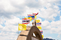 Waving Thai flag of Thailand with blue sky background. Royalty Free Stock Photo