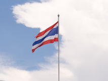 Waving Thai national flag. With clouds and blue sky background stock photos