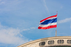 Waving Thailand flag and blue sky. Waving Thailand flag on the railway station and blue sky Royalty Free Stock Photography