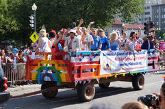 Waving to the Crowd at the Parade. Photo of men and women waving to the crowd at the capital pride parade in washington dc on 6/7/14.  This parade takes place at Stock Images