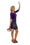 Waving to friends while shopping Royalty Free Stock Photography