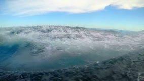 Waving, through the transparent bottom of a ship stock footage