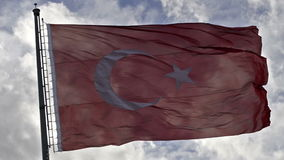 Waving Turkish flag on. A cloudy sky background stock video footage