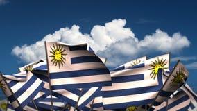 Waving Uruguayan Flags. Seamless & alpha channel stock footage