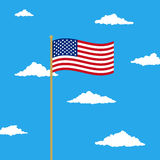 Waving USA flag in the cloudy sky Royalty Free Stock Images