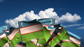 Waving Uzbek Flags. (seamless & alpha channel stock video footage