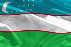 Waving Uzbekistan flag for using as texture or background, the flag is fluttering on the wind. Fluttering Uzbekistan flag for using as texture or background, the stock photography