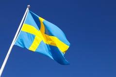 Waving on wind Swedish flag over deep blue sky Stock Image