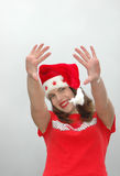 Waving woman in Santa hat royalty free stock photo