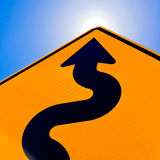 Wavy arrow on road sign pointing up for success Stock Image