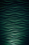 Wavy background green. Lights and darks Royalty Free Stock Photo