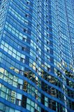 Wavy Blue Building. A generic blue skyscraper with wavy designs built into its structure Stock Images