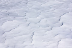 Wavy blue snow surface Stock Photo