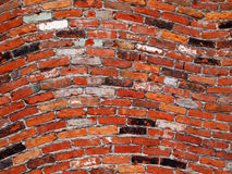 Wavy Brick Wall Background. Red background image featuring bricks in horizontal waving pattern Stock Photography