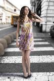 Wavy brunette with colored dress looks at left Royalty Free Stock Photography