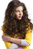 Wavy brunette with yellow jacket looks at left Royalty Free Stock Photo