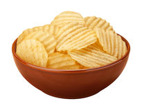Wavy Chips in a Bowl. Wavy potato chips with ridges, sometimes called ruffles, in a brown ceramic bowl isolated on a white background. A salty snack associated Royalty Free Stock Image