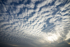 Wavy clouds. That can see a through gap of blue sky Royalty Free Stock Photography