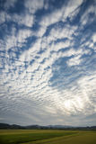Wavy clouds. That can see a through gap of blue sky in vertical composition Royalty Free Stock Photo