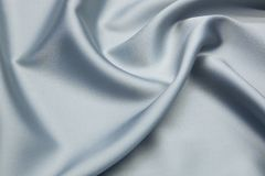 Wavy fabric closeup texture background. Wavy blue-gray luxurios silk fabric texture closeup for backgrounds or product show high resolution Royalty Free Stock Image