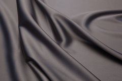 Wavy fabric closeup texture background. Wavy dark chocolate luxurios silk fabric texture closeup for backgrounds or product show high resolution Stock Images