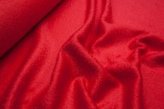 Wavy fabric closeup texture background. Wavy red wool fabric texture closeup for backgrounds or product show high resolution Royalty Free Stock Photography