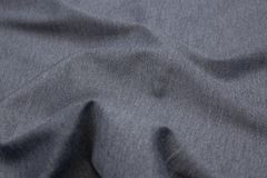 Wavy fabric closeup texture background. Wavy gray melange jersey fabric texture closeup for backgrounds or product show high resolution Stock Photography