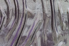 Wavy fabric of iridescent motley colors Royalty Free Stock Photo