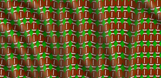 Wavy football pigskin pattern illustration with green background Royalty Free Stock Images