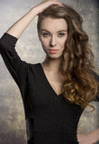 Wavy girl in fashion pose Royalty Free Stock Photography