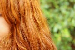 Wavy gold hairs of a beautiful women Stock Image
