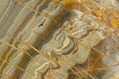 Wavy Granite Sample. Grey, Orange, and Black Granite Stock Image