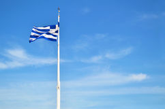 Wavy greek flag with blue sky background Royalty Free Stock Photos