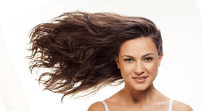 Wavy hair. Pretty girl with long blowing wavy hair royalty free stock images