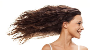 Wavy hair. Pretty girl with long blowing wavy hair royalty free stock photos