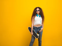 Wavy haired teenage girl standing royalty free stock image
