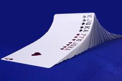 Wavy line. There are playing cards in the photo. These are in wave formation Royalty Free Stock Images