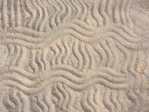Wavy lines in the sand. Sand painted horizontal and vertical wavy lines Royalty Free Stock Photography