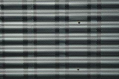 Wavy metallic texture made with rounded holes. To decorate a facade Stock Images