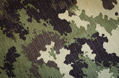 Wavy Military vegetato camouflage rip-stop fabric texture background Royalty Free Stock Photo