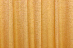 Wavy orange silky curtain backdrop Royalty Free Stock Image