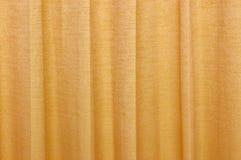 Wavy orange silky curtain backdrop Royalty Free Stock Image